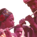 Adele Sebastian and Aubrey Hart in concert with the Arkestra, Exposition Park, Los Angeles, mid 1970s (© Kamau Daáood)