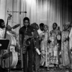 The Arkestra and Voices in concert. Roberto Miranda, left bass; Shams (Ray Straughter), tenor sax, 1976 (© James Andrews)