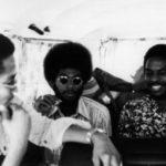 Ernest Straughter; Jamil Shabaka; Shams (Ray Straughter) – inside James Andrews' van outside of the IUCC, 1976 (© James Andrews)