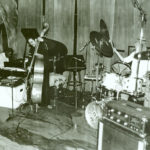 Horace Tapscott Trio performing live at the Century City Playhouse, c.1980. L to R: Horace, piano; Roberto Miranda, bass; Alex Cline, drums. (© Mark Weber)